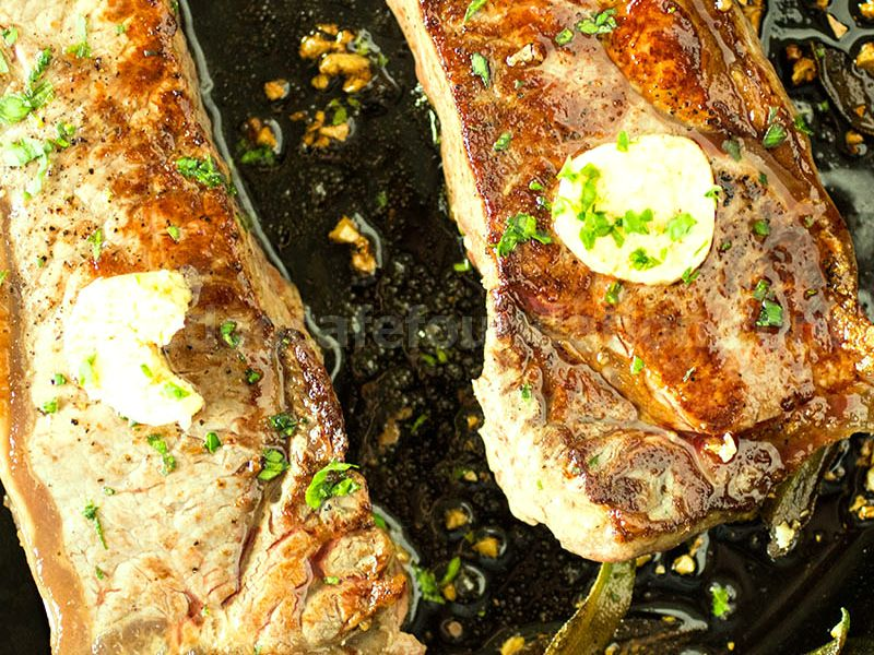 Pan Seared New York Strip Steak with Garlic-Bourbon Butter