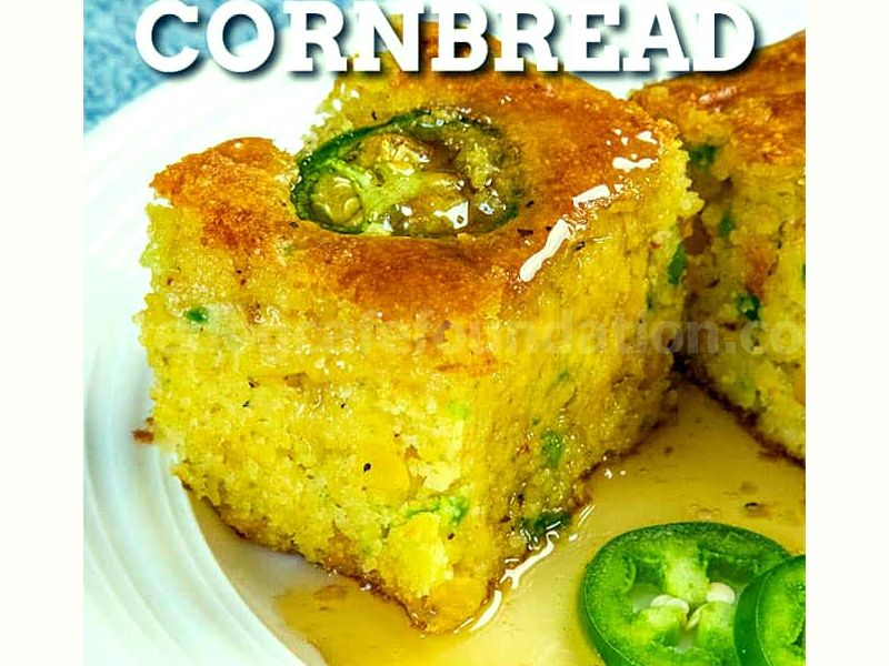 Jalapeno Cornbread Recipe - This jalapeno cornbread recipe is incredibly moist with lots of spicy jalapeno peppers and cheddar cheese. Great for the holidays or an anytime side dish! #Cornbread #JalapenoPeppers #SideDish